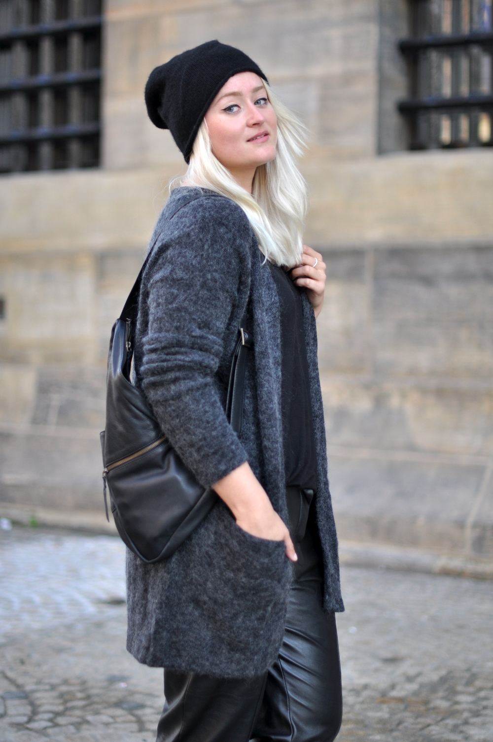 outfit baggy leather trousers nike roshe metric hm trend mohair vest cos beanie ganni bag