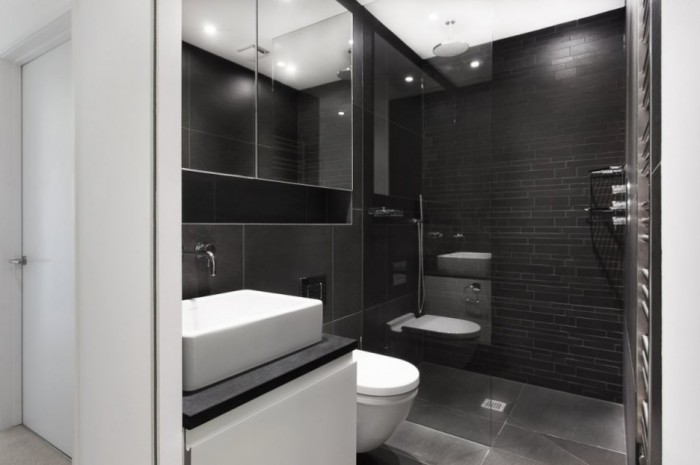 Luxurious-Glass-Shower-Room-with-Black-Wall-in-Medics-House-Completed-with-Black-Tiled-Wall-to-Blend-with-White-Ceiling-936x623